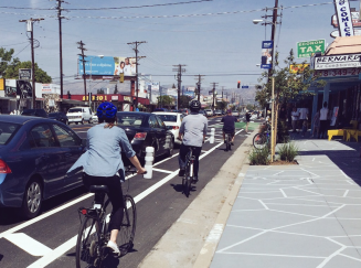 Bicycle riders traveling in protected bicycle lanes on Reseda Blvd. in Northridge, CA